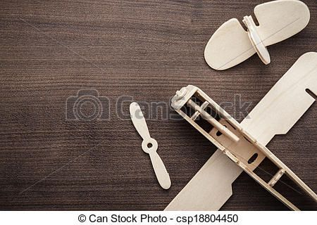 handmade airplane on brown wooden table - handmade airplane on the brown wooden table